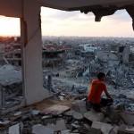 Palestinians return their homes during ceasefire in Gaza's al-Shaaf neighborhood
